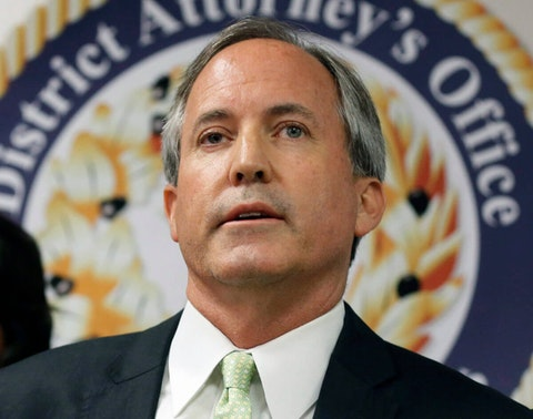 In this June 22, 2017, file photo, Texas Attorney General Ken Paxton speaks at a news conference in Dallas. Records reviewed by The Associated Press show that an exclusive group of Texans stood to benefit when Paxton, urged a small Colorado county to reverse a public health order during the coronavirus outbreak. Paxton this month told Gunnison County that banning Texans from their property in Colorado during the outbreak was unconstitutional. (AP Photo/Tony Gutierrez, File)