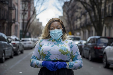 Tiffany Pinckney poses for a portrait in the Harlem neighborhood of New York on April 1, 2020. (AP Photo/Marshall Ritzell)