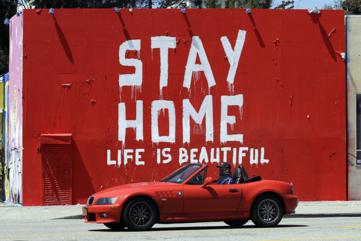 "FILE - In this Tuesday, April 14, 2020 file photo, a mural reads ""Stay Home, Life is Beautiful' in Los Angeles. (AP Photo/Marcio Jose Sanchez)"