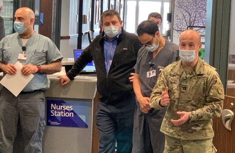Rep. Max Rose, in fatigues, deployed with the National Guard to set up a hospital for coronavirus patients in New York.
