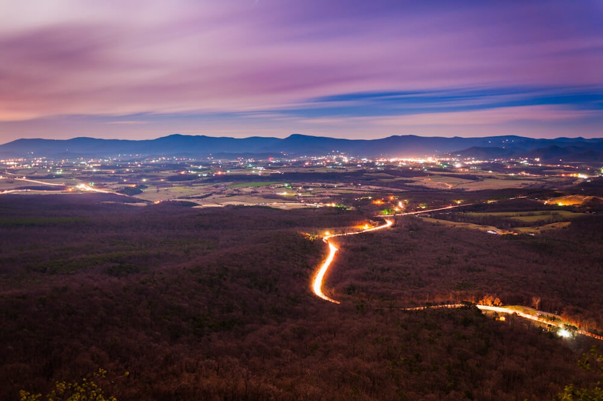 View of the Shenandoah Valley and Luray at night from Massanutten Mountain (Photo via Shutterstock)