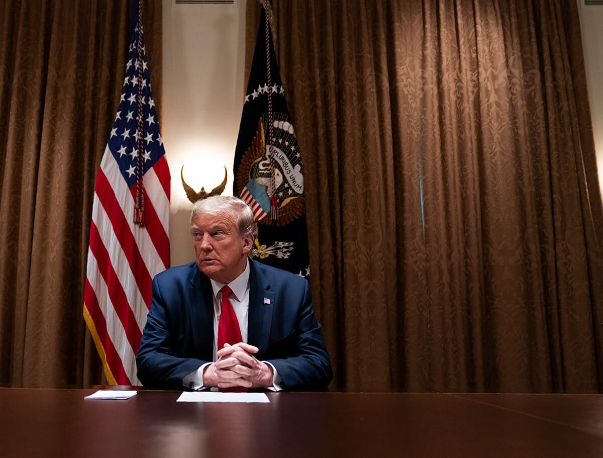 President Donald Trump listens during a meeting with health care executives, in the Cabinet Room of the White House, Tuesday, April 14, 2020, in Washington. (AP Photo/Evan Vucci)