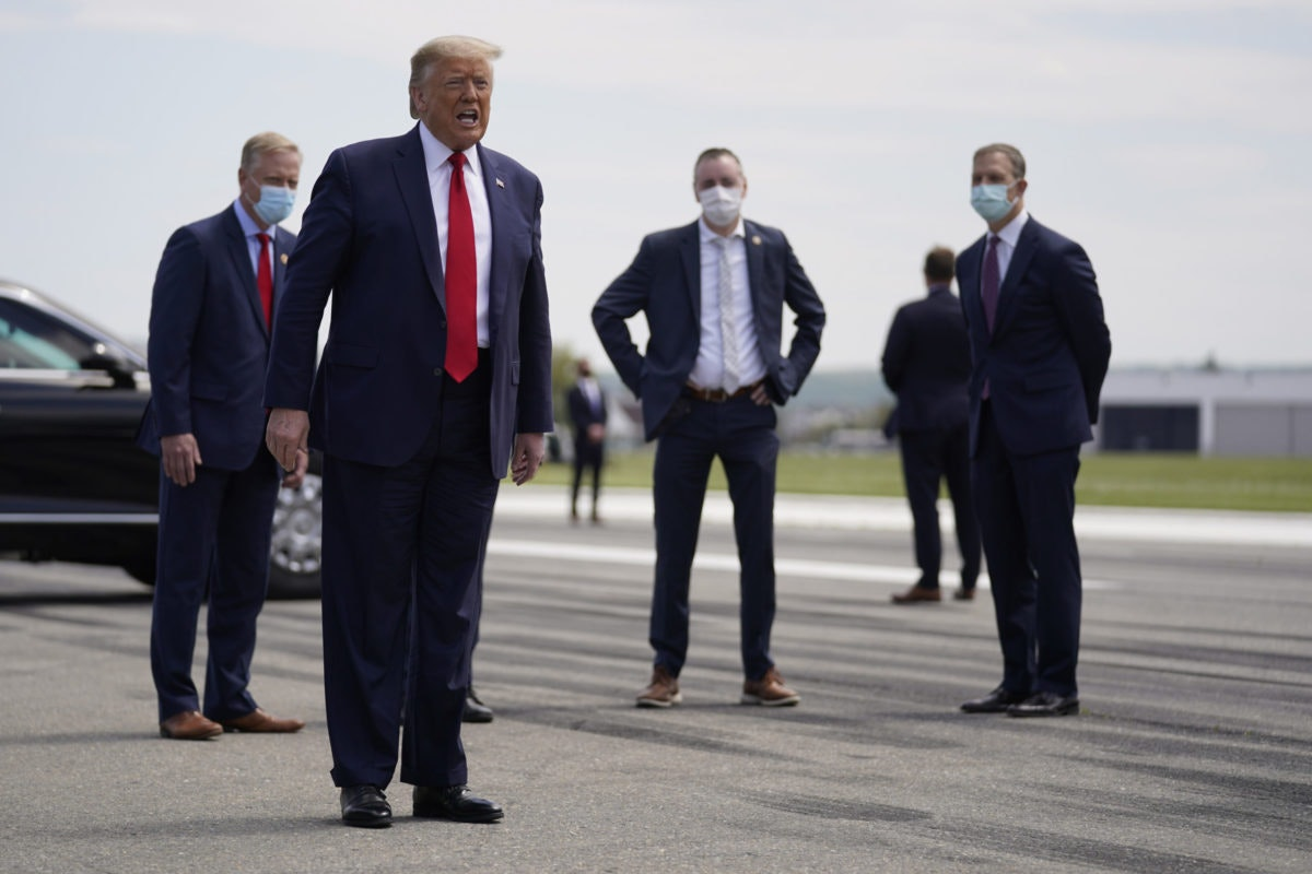 President Donald Trump speaks after exiting Air Force One at Lehigh Valley International Airport in Allentown, Pa., Thursday, May 14, 2020. (AP Photo/Evan Vucci)