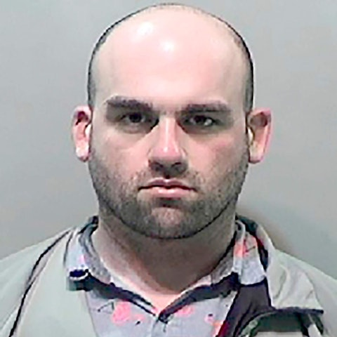 This undated booking photo provided by the Detroit Police Public Safety Office shows Robert Tesh, 32, who has been charged with terrorism for making credible death threats against Michigan Gov. Gretchen Whitmer and Attorney General Dana Nessel. Wayne County prosecutor Kym Worthy said Friday, May 15, 2020, that Tesh made the threats via social media to an acquaintance on April 14.  (Detroit Police Public Safety Office via AP)