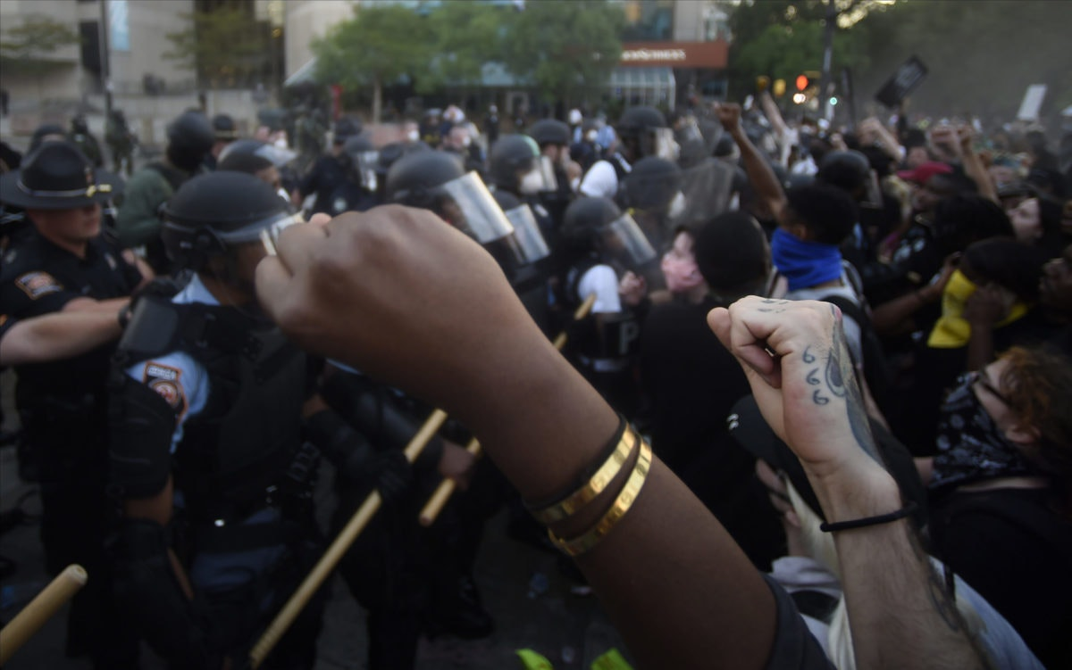 Police officers and protesters clash near CNN center, Friday, May 29, 2020 in Atlanta. (AP Photo/Mike Stewart)