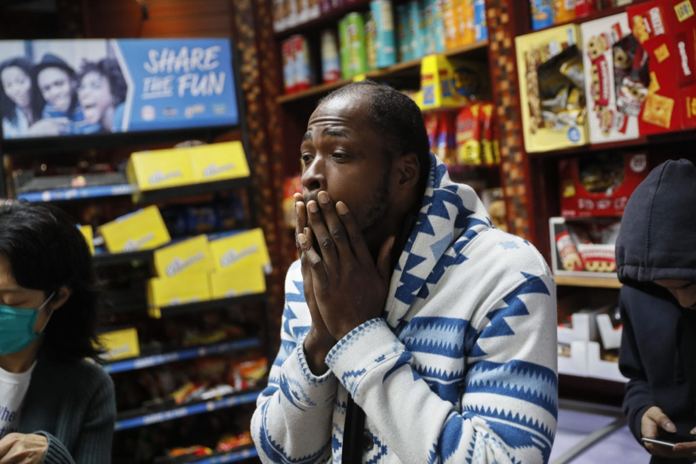 Brandon B., 32, who lives with schizophrenia waits for a sandwich order purchased by Dr. Jeanie Tse, chief medical officer at the Institute for Community Living, left, as she makes her rounds treating patients, Wednesday, May 6, 2020, in the Brooklyn borough of New York. (AP Photo/John Minchillo)