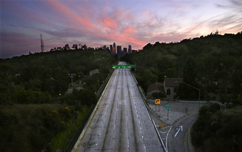 In this April 26, 2020, file photo, empty lanes of the 110 Arroyo Seco Parkway that leads to downtown Los Angeles is seen during the coronavirus outbreak in Los Angeles, Calif.  (AP Photo/Mark J. Terrill, File)
