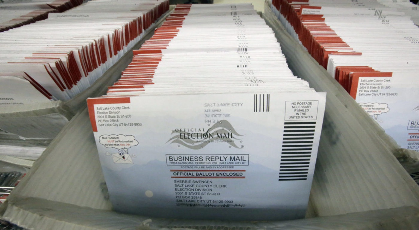 In this Nov. 1, 2016, file photo, mail-in ballots for the 2016 General Election are shown at the elections ballot center at the Salt Lake County Government Center, in Salt Lake City. (AP Photo/Rick Bowmer, File)