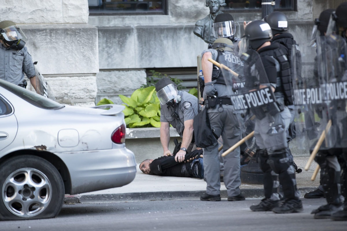 Kentucky State Police detain a man on West Liberty Street on Sunday, May 31, 2020, in downtown Louisville, Kentucky. (Max Gersh/The Courier Journal)