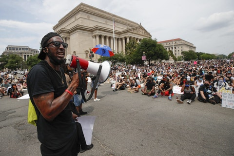 In this June 6, 2020, file photo, demonstrators protest near the National Archives on Pennsylvania Avenue in Washington, over the death of George Floyd, a black man who was in police custody in Minneapolis. Juneteenth 2020 will be a day of protest in may places Friday, June 19. (AP Photo/Alex Brandon, File)