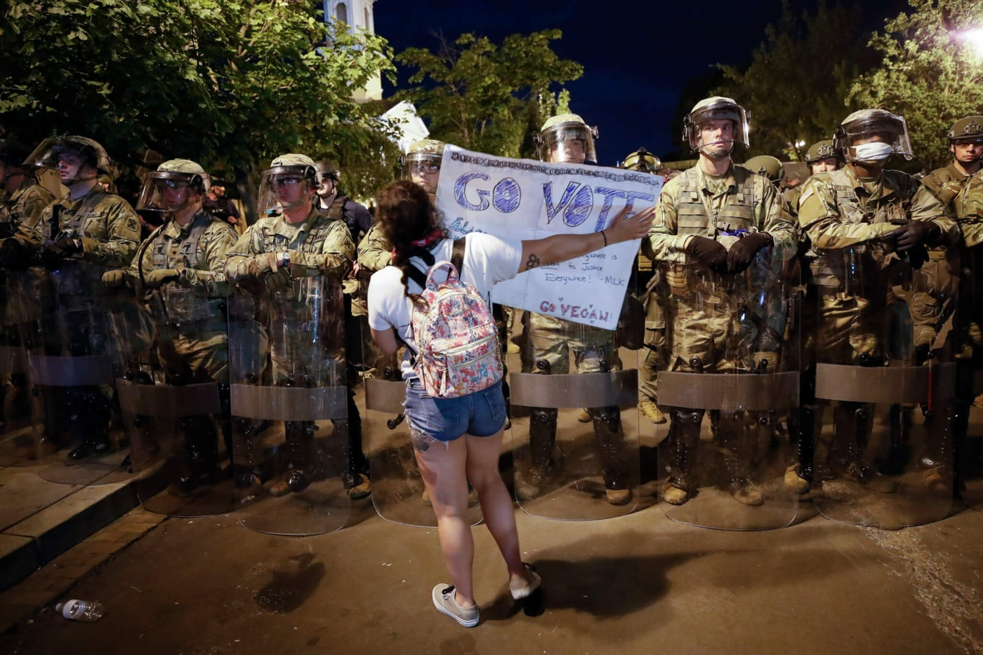 Utah National Guard soldiers stand on a police line as demonstrators gather to protest the death of George Floyd, Thursday, June 4, 2020, near the White House in Washington. (AP Photo/Alex Brandon)