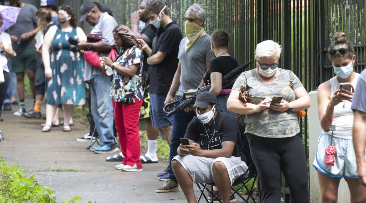 When some Georgia voters endured a pandemic, pouring rain and massive waits earlier this month to cast their ballot, President Donald Trump and other Republicans blamed local Democrats for presiding over chaos. (AP Photo/John Bazemore, File)