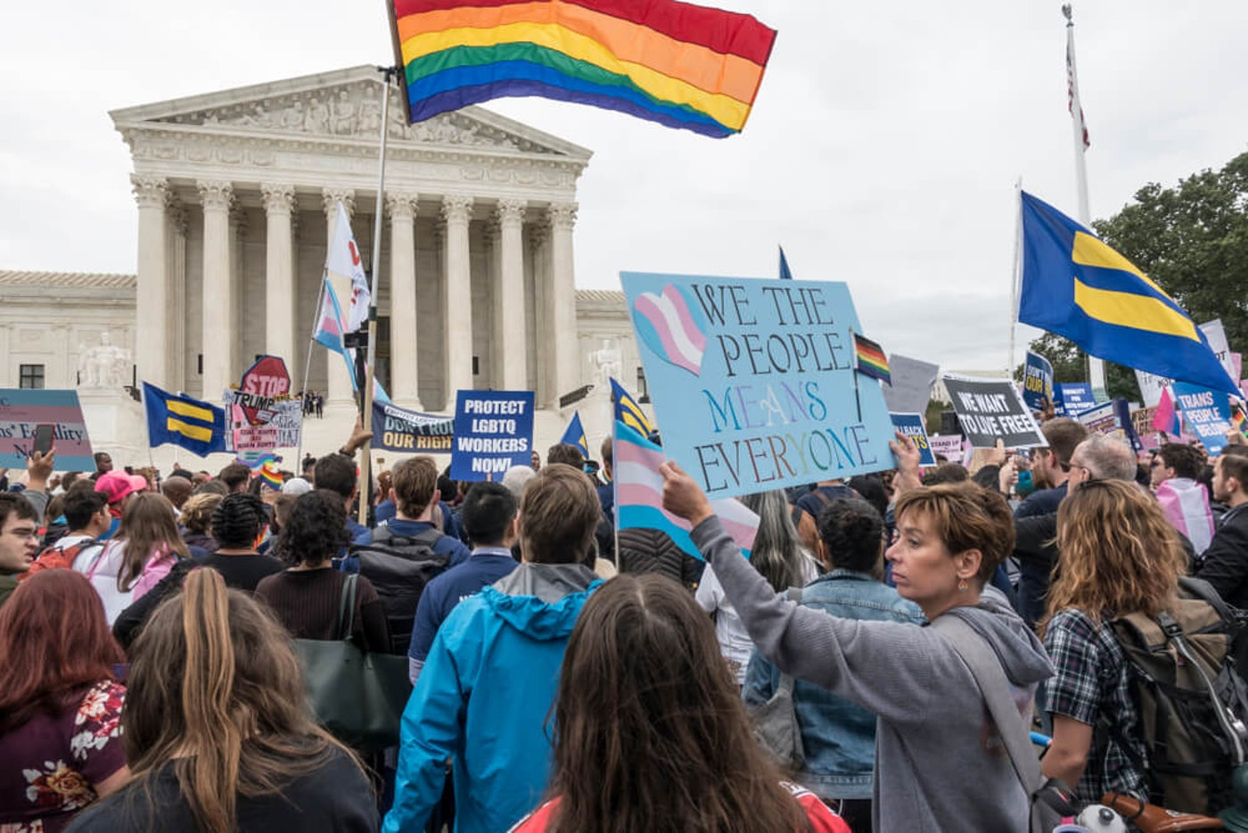 WASHINGTON, DC - OCT. 8, 2019: Rally for LGBTQ rights outside Supreme Court as Justices hear oral arguments in three cases dealing with discrimination in the workplace because of sexual orientation (Image via Shutterstock)