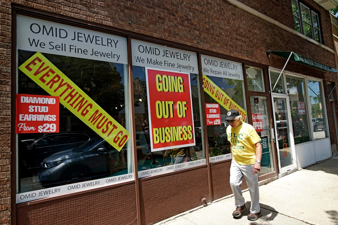 A man walks past a retail store that is going out of business due to the coronavirus pandemic in Winnetka, Ill., Tuesday, June 23, 2020. (AP Photo/Nam Y. Huh)