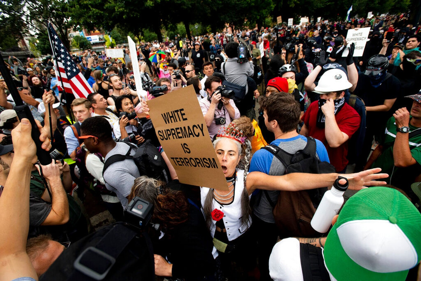 "A counter-protester confronts members of the Proud Boys and other right-wing demonstrators during an ""End Domestic Terrorism"" rally in Portland, Ore., on Saturday, Aug. 17, 2019. (AP Photo/Noah Berger)"