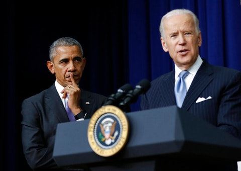 Former President Barack Obama listens as former Vice President Joe Biden speaks in the South Court Auditorium in the Eisenhower Executive Office Building on the White House complex in Washington. (AP Photo/Carolyn Kaster, File)