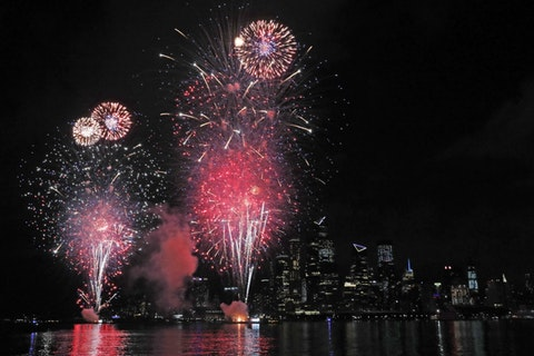 A surprise display of fireworks sponsored by Macy's explode over the Hudson Yards area of Manhattan as seen from a pier in Hoboken, N.J., Tuesday, June 30, 2020. The fireworks were not announced until an hour or so before to avoid attracting large crowds. (AP Photo/Kathy Willens)