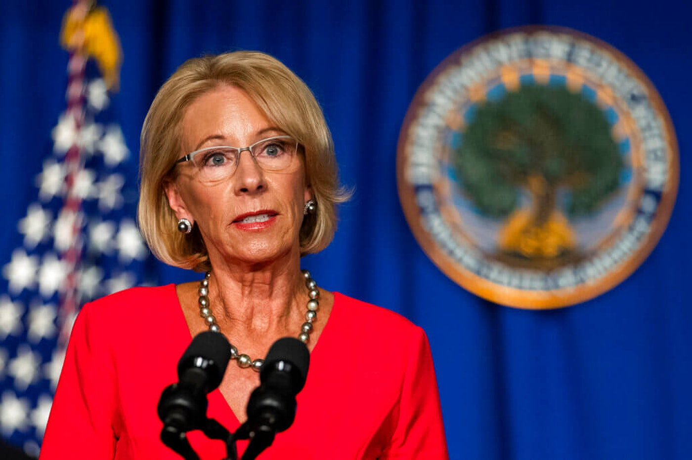 In this July 8, 2020, photo, Education Secretary Betsy DeVos speaks during a briefing at the Department of Education building in Washington. On Wednesday, July 15, 2020, attorneys general from 22 states plus the District of Columbia sued the Trump administration to block new federal rules they say would make it harder for students swindled by for-profit colleges to get relief from their federal loans. The new regulations were put in place last year by Secretary DeVos. (AP Photo/Manuel Balce Ceneta, File)