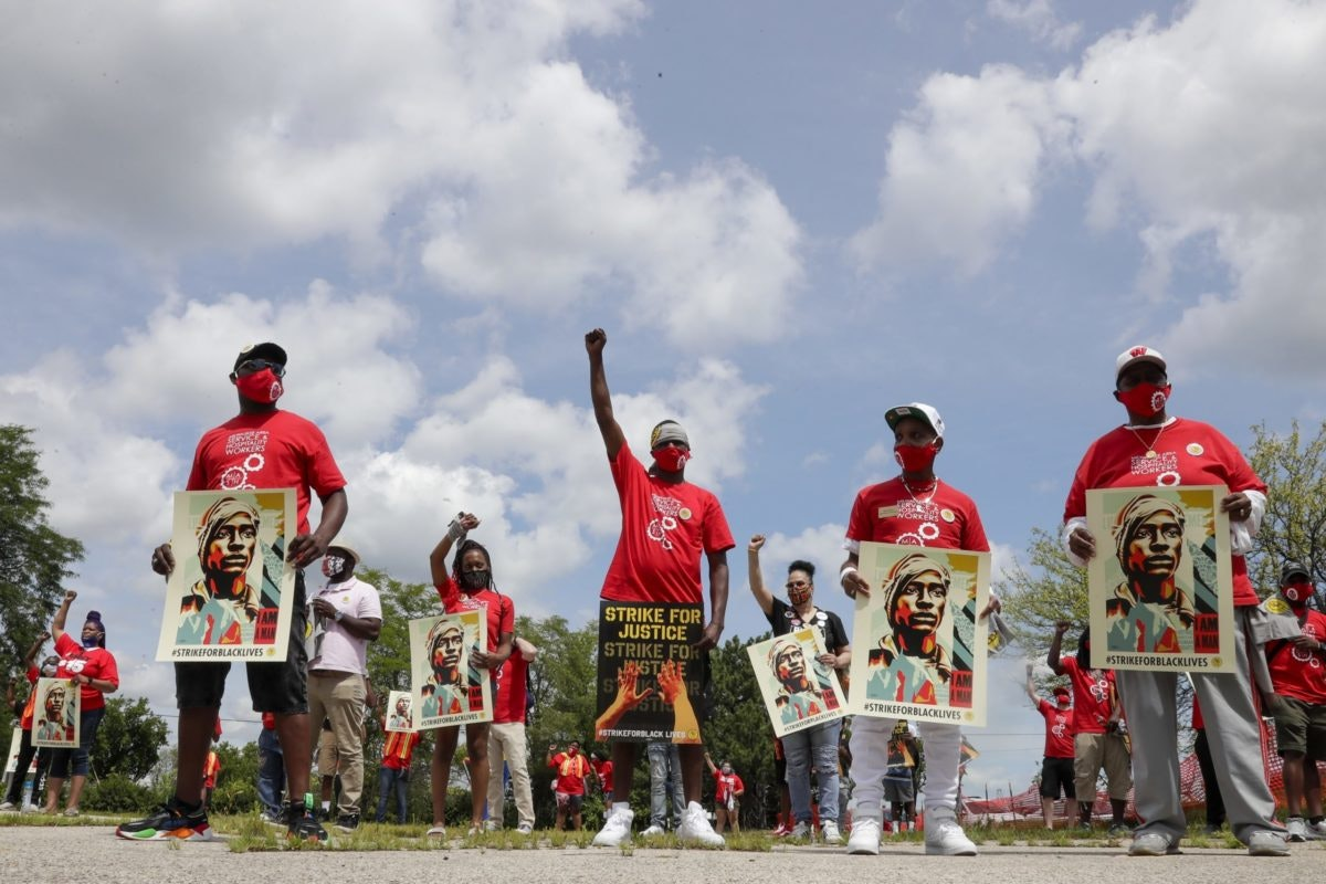 Strike for justice protesters are seen Monday, July 20, 2020, in Milwaukee, Wisconsin. (AP Photo/Morry Gash)