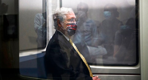 Senate Majority Leader Mitch McConnell of Ky. rides the subway to a meeting, July 21 on Capitol Hill. Congress is just starting to negotiate new legislation to renew coronavirus aid.  (AP Photo/Jacquelyn Martin)