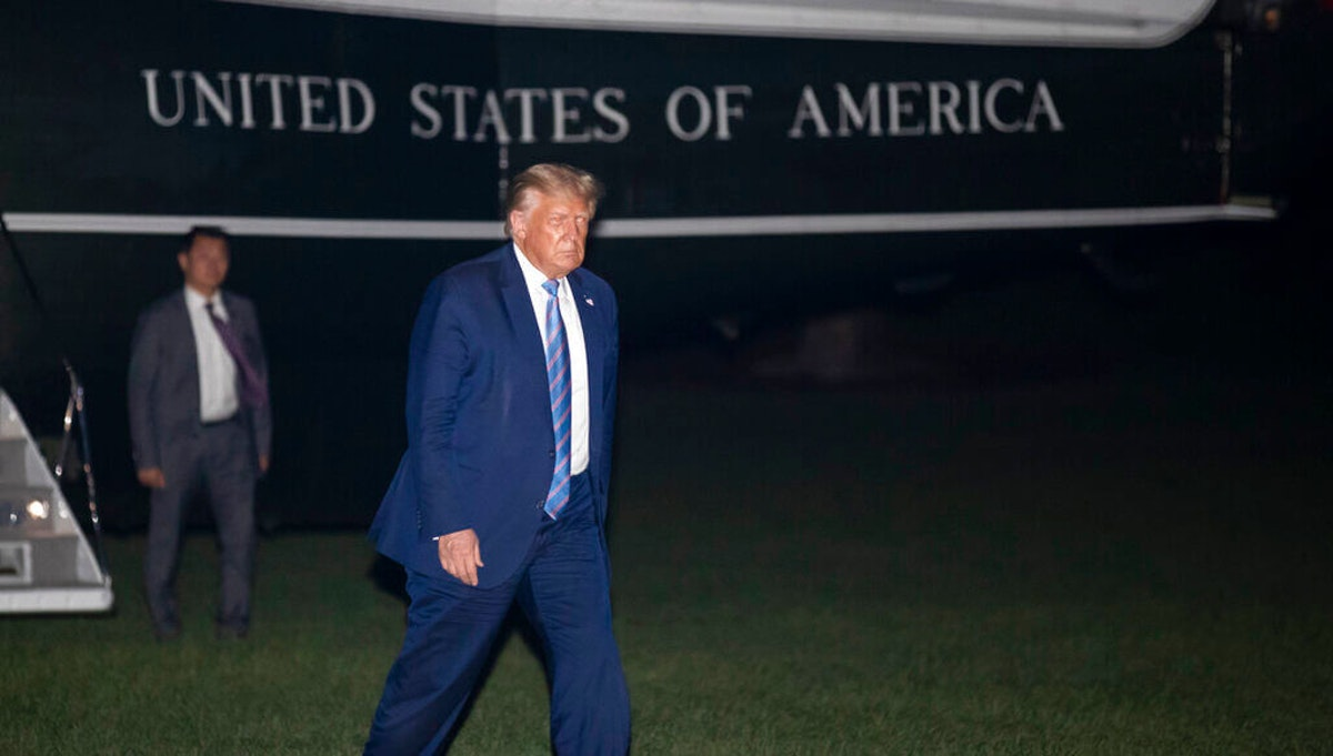 President Donald Trump walks from Marine One as he returns to the White House from Texas, Wednesday, July 29, 2020, in Washington. (AP Photo/Alex Brandon)