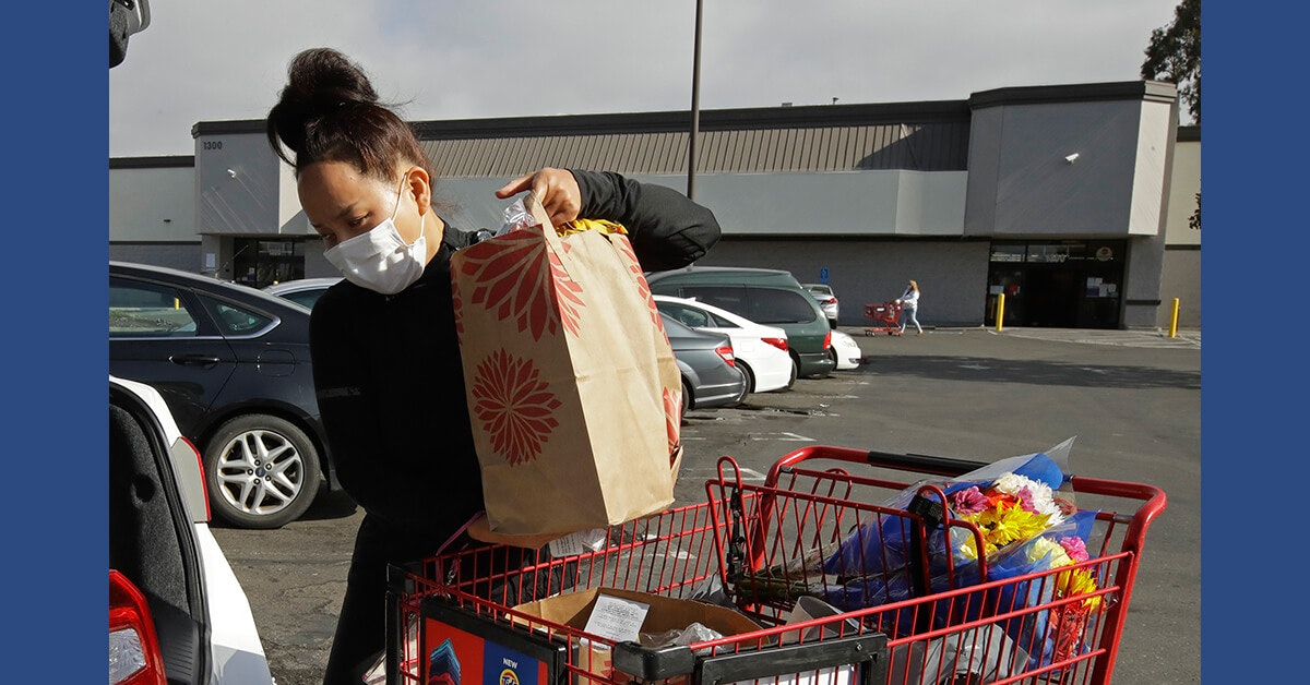 Instacart worker Saori Okawa loads groceries into her car for home delivery on Wednesday, July 1, 2020, in San Leandro, Calif. (AP Photo/Ben Margot)