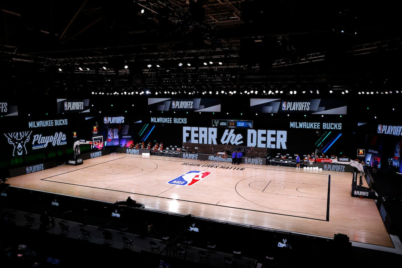 Referees huddle on an empty court at game time of a scheduled game between the Milwaukee Bucks and the Orlando Magic for Game Five of the Eastern Conference First Round during the 2020 NBA Playoffs at AdventHealth Arena at ESPN Wide World Of Sports Complex on August 26, 2020 in Lake Buena Vista, Florida. (Photo by Kevin C. Cox/Getty Images)
