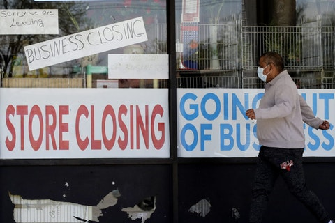 Signs of a closed store due to COVID-19 in Niles, Ill.
