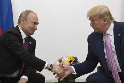 President Donald Trump shakes hands with Russian President Vladimir Putin during the G-20 summit in Osaka, Japan in 2019. (AP Photo/Susan Walsh, File)