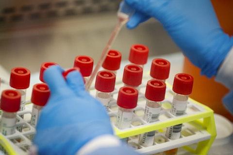 A technician prepares COVID-19 coronavirus patient samples for testing. (AP Photo/John Minchillo)