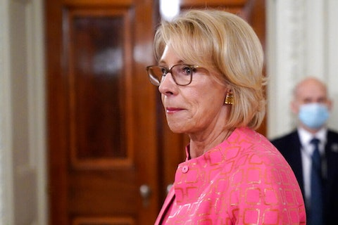 Education Secretary Betsy DeVos arrives for an event in the State Dining room of the White House, Wednesday, Aug. 12, 2020, in Washington. A federal judge on Wednesday allowed the Education Department to move forward with new rules governing how schools and universities respond to complaints of sexual assault. (AP Photo/Andrew Harnik, File)