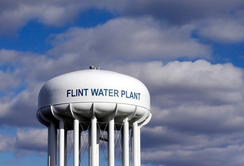 FILE - In this March 21, 2016, file photo, the Flint Water Plant water tower is seen in Flint, Mich. Multiple news outlets report Wednesday, Aug. 19, 2020, that the state of Michigan has reached a $600 million agreement to compensate Flint residents whose health was damaged by lead-tainted drinking water. (AP Photo/Carlos Osorio, File)