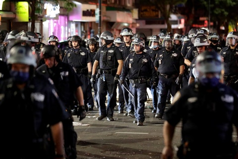 Police have deployed a variety of violent tactics against protestors since May. (AP Photo/Seth Wenig)