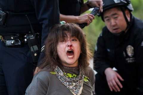 A demonstrator is arrested by police during a protest in support of the two-month long police protest movement in Portland, Oregon, Saturday, July 25, 2020 in Los Angeles. Image via Shutterstock