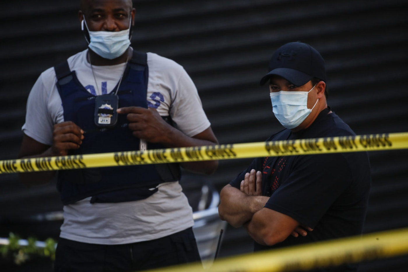 Police officers respond to a crime scene where a 23-year-old man was discovered with gunshot wounds to his legs and torso before being transported to a hospital where he died from his injuries in Brooklyn, New York. (AP Photo/John Minchillo)