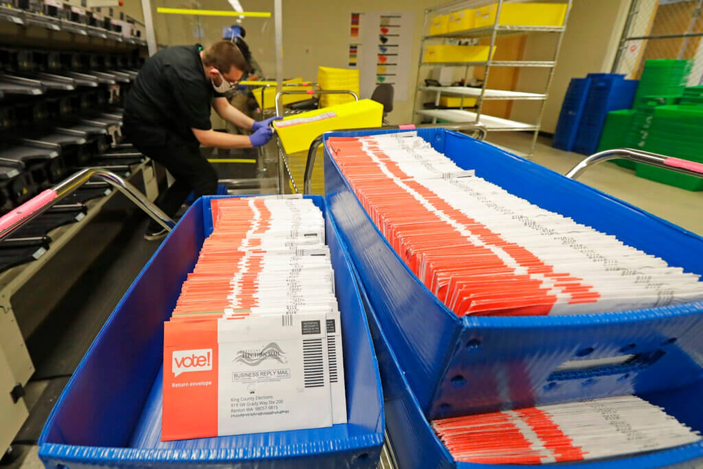 In this Aug. 5, 2020, file photo, vote-by-mail ballots are shown in sorting trays at the King County Elections headquarters in Renton, Wash., south of Seattle. Washington is one of the states that does all vote-by-mail, a voting method getting more attention due to the COVID-19 pandemic. (AP Photo/Ted S. Warren, File)