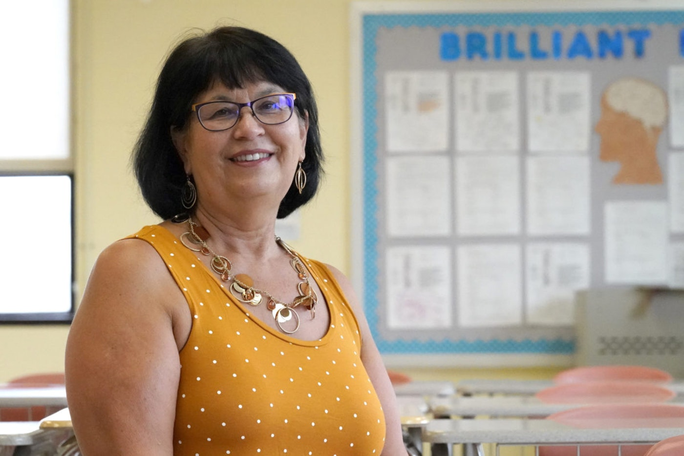 Geraldine Swann, director of community outreach at Hampstead Hill Academy in Baltimore, poses for a photograph Monday, Aug. 31, 2020, in Baltimore. The pandemic has Geri Swann working her cell phone constantly, as she gets up to 100 emails a day seeking help for students and their families. (AP Photo/Julio Cortez)