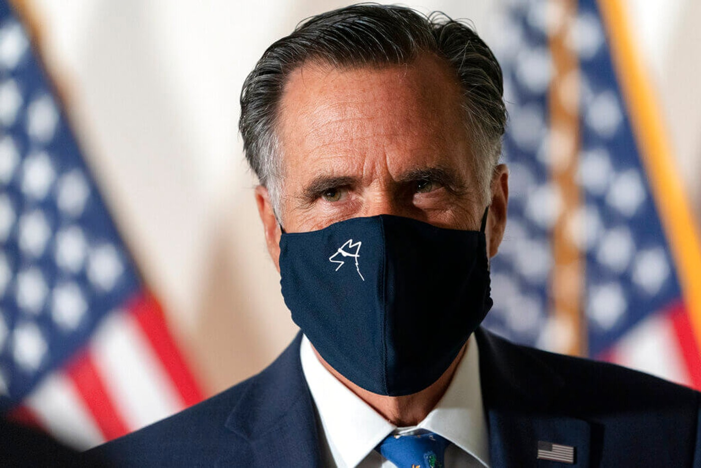 Sen. Mitt Romney, R-Utah, arrives for a meeting with Senate Republicans, Wednesday, Sept. 9, 2020, on Capitol Hill in Washington. (AP Photo/Jacquelyn Martin)