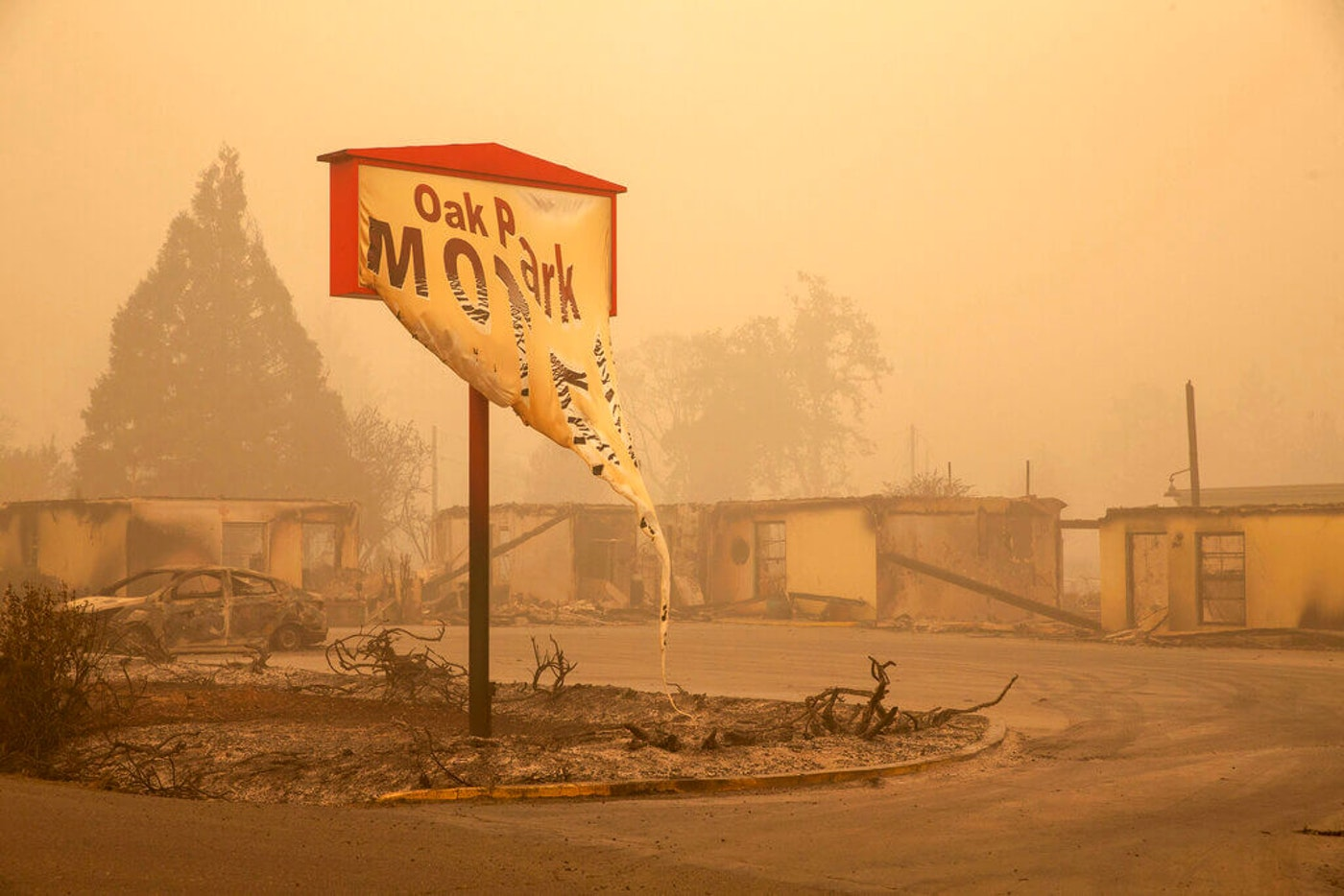The Oak Park Motel was destroyed by the flames of the Beachie Creek Fire east of Salem, Ore., Sunday, Sept. 13, 2020.  (Rob Schumacher/Statesman-Journal via AP, Pool)