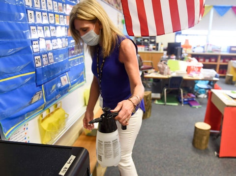 First Grade teacher Dianna Accordino with the disinfectant mist sprayer for her classroom. (Photo by Ben Hasty/MediaNews Group/Reading Eagle via Getty Images)