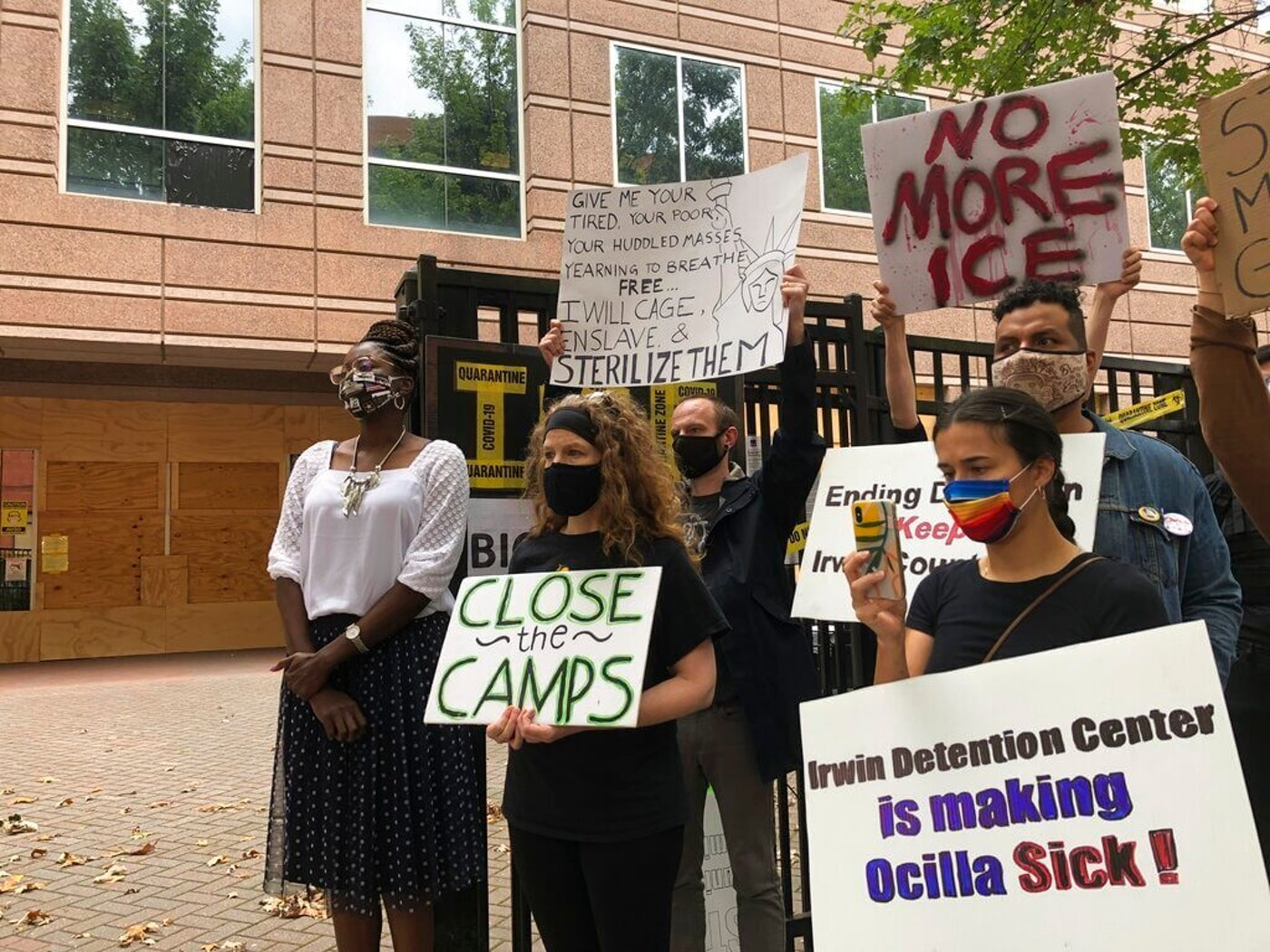 Dawn Wooten, left, a nurse at Irwin County Detention Center in Ocilla, Georgia, speaks at a Tuesday, Sept. 15, 2020 news conference in Atlanta protesting conditions at the immigration jail. Wooten says authorities denied COVID-19 tests to immigrants, performed questionable hysterectomies and shredded records in a complaint filed to the inspector general of the U.S. Department of Homeland Security. (AP Photo/Jeff Amy)