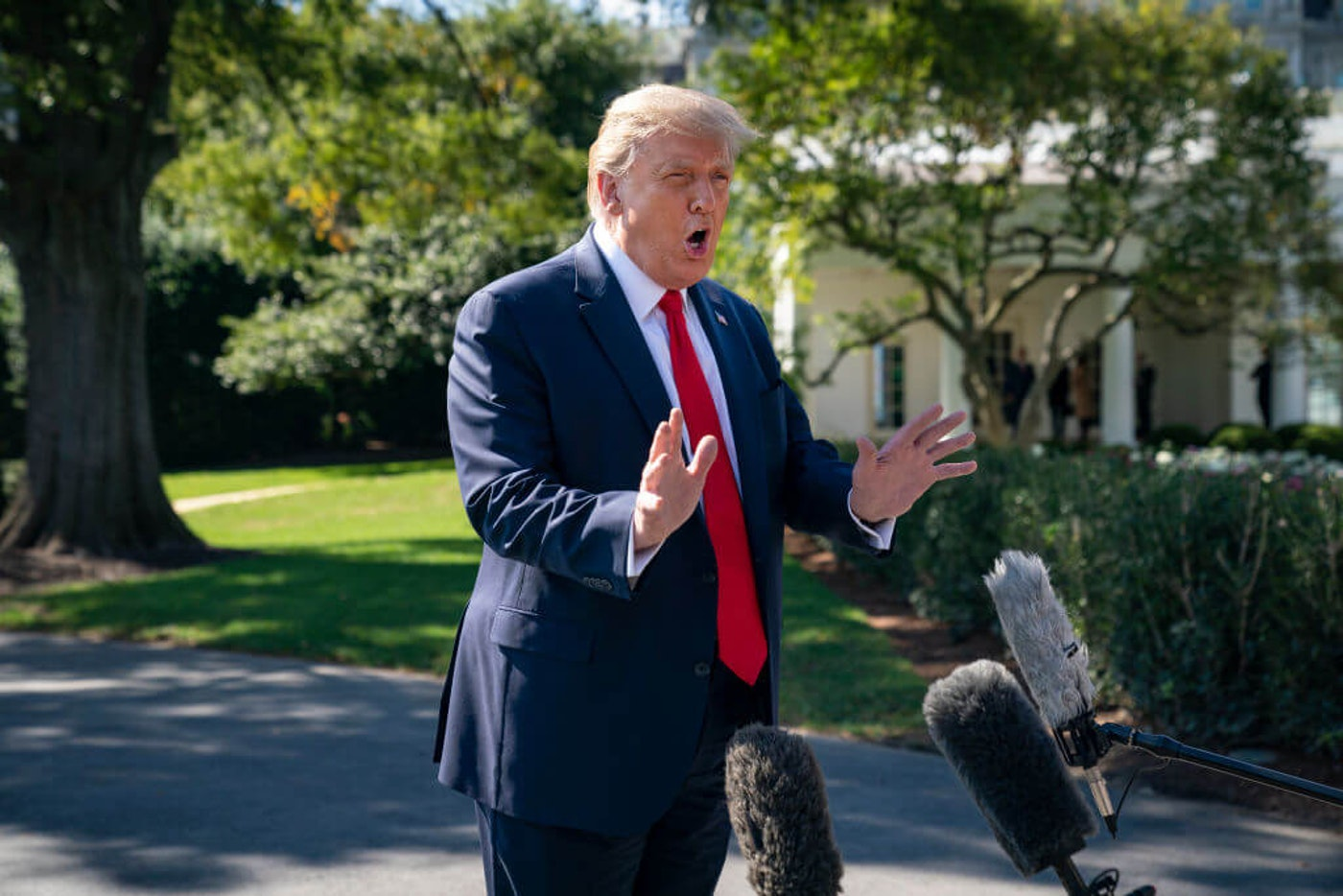 President Donald Trump speaks to reporters on his way to Marine One on the South Lawn of the White House on September 30, 2020 in Washington, DC. President Trump is traveling to Minnesota for a fundraising event and a campaign rally. (Photo by Drew Angerer/Getty Images)