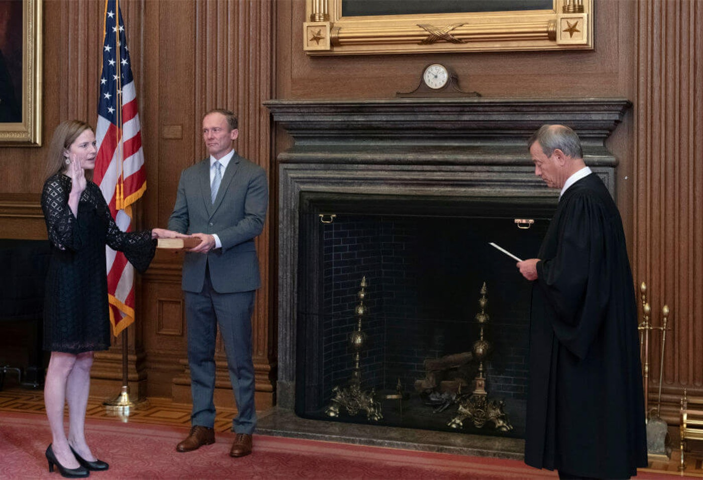 Chief Justice John G. Roberts (R) administers the Judicial Oath to U.S. Supreme Court Associate Justice Amy Coney Barrett as her husband Jesse Barrett holds the Bible in the East Conference Room, Supreme Court Building on October 27, 2020 in Washington, DC. (Photo by Fred Schilling/Collection of the Supreme Court of the United States via Getty Images)