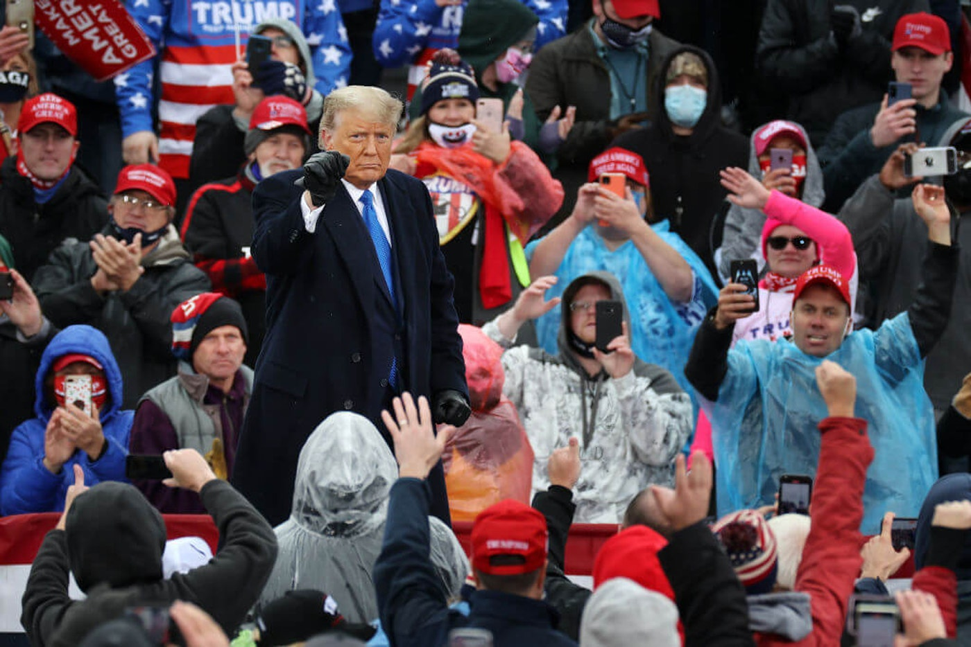 U.S. President Donald Trump pumps his fist after addressing supporters during a campaign rally at Capital Region International Airport October 27, 2020 in Lansing, Michigan. With one week until Election Day, Trump is campaigning in Michigan, a state he won in 2016 by less than 11,000 votes, the narrowest margin of victory in the state's presidential election history.  (Photo by Chip Somodevilla/Getty Images)