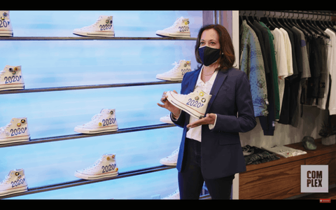 Vice presidential candidate Kamala Harris, at a Charlotte sneaker shop, shows off the new shoe designed for her. (Image via screenshot)