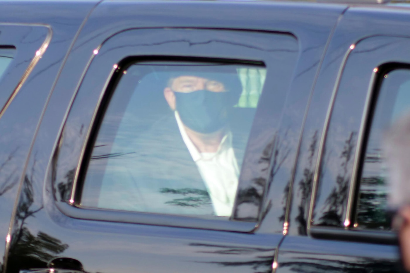Contrary to the CDC's recommendations, President Trump left Walter Reed Medical Center over the weekend in a car full of Secret Service officers to wave to his supporters (AP Photo/Anthony Peltier).