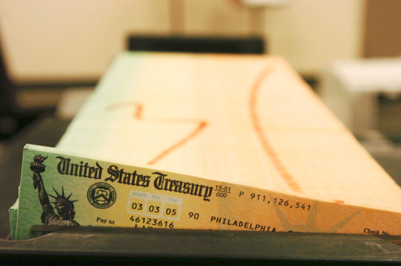 In this Feb. 11, 2005 file photo, trays of printed social security checks wait to be mailed from the U.S. Treasury's Financial Management services facility in Philadelphia. (AP Photo/Bradley C. Bower, File)
