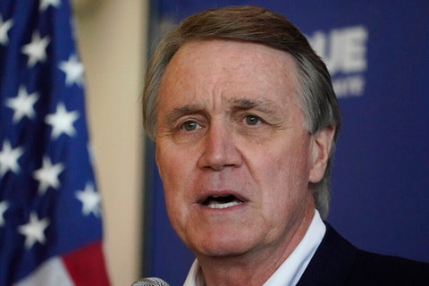 Republican candidate for Senate Sen. David Perdue during a campaign stop at Peachtree Dekalb Airport Monday, Nov. 2, 2020, in Atlanta. (AP Photo/John Bazemore)