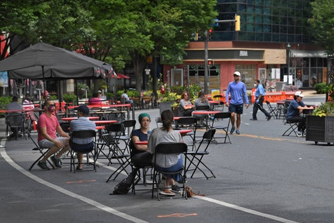 A section of Woodmont Ave. in Bethesda has been closed off to help local restaurants in need of more table space due to social distancing guidelines. There are tables in the middle of the road that would normally be filled with automobile traffic in Bethesda, Maryland on June 15, 2020. The project, called Bethesda Streetery runs from 11:00am to 10:00pm seven days a week. (Photo by Michael S. Williamson/The Washington Post via Getty Images)