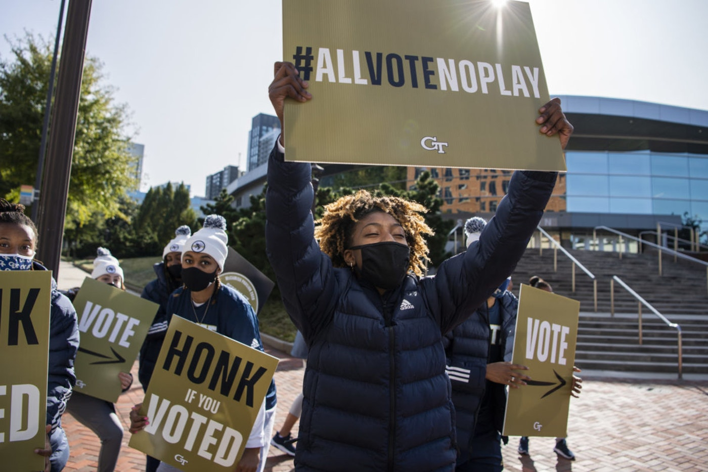 Members of the Georgia Tech Womens basketball team, hold voting signs outside of McCamish Pavillion which served as a polling place on Election Day in Atlanta, Ga., on Tuesday, November 3, 2020. (Photo By Tom Williams/CQ-Roll Call, Inc via Getty Images)
